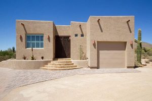 Southwestern style home with one car garage